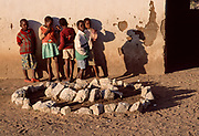 Students and wall, Detema School, Zimbabwe, May 1995