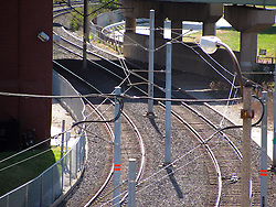 20 October 2010:  Still working rail road tracks with scattered lines and poles pass to the south west of the St. Louis Union Station.  St. Louis Missouri