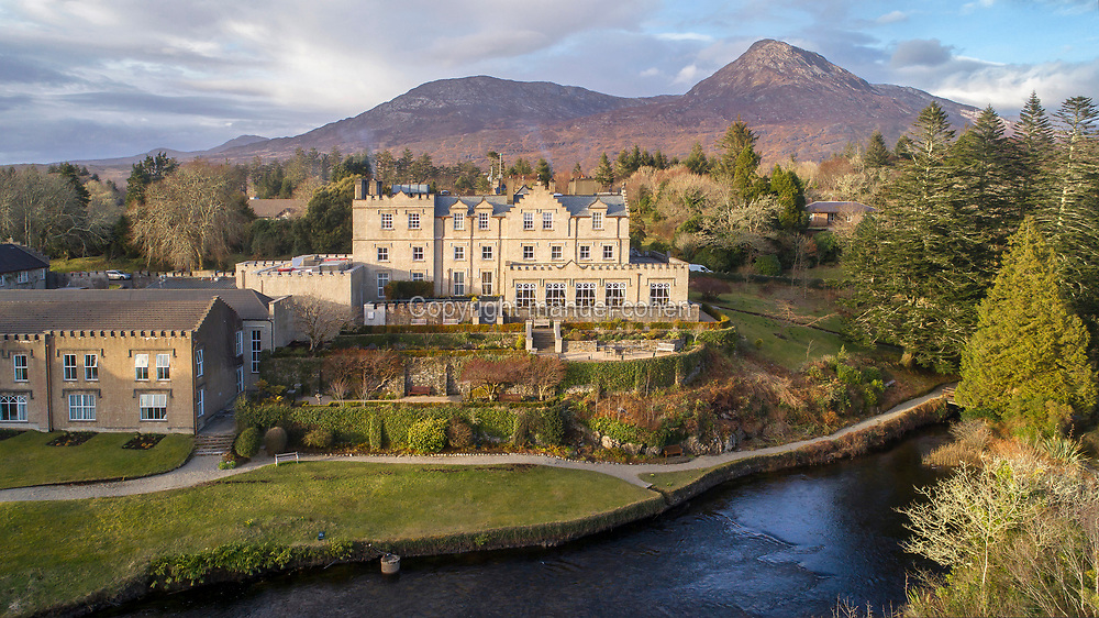 Aerial view of Ballynahinch Castle, built in the 18th century, now a luxury hotel, in the Twelve Bens mountain range, Connemara, County Galway, Ireland. The first castle was built here in 1546 on Ballynahinch Lake by Donal O'Flaherty, husband of Grace O'Malley or Grainneuaile. The present house was built in 1756 by the Martin family. Picture by Manuel Cohen