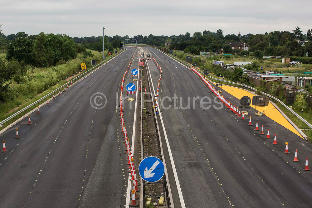 The M4 is pictured clear of traffic during a weekend closure between Junctions 5 and 6 for smart motorway conversion works by Highways England on 20th June 2021 in Datchet, United Kingdom. All lane running motorways, including those such as the M4 currently under construction, will require radar technology to detect stopped cars.