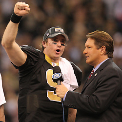 Jan 24, 2010; New Orleans, LA, USA; New Orleans Saints quarterback Drew Brees (9) talks to Fox broadcaster Chris Myers following a 31-28 overtime victory by the New Orleans Saints over the Minnesota Vikings in the 2010 NFC Championship game at the Louisiana Superdome. Mandatory Credit: Derick E. Hingle-US PRESSWIRE