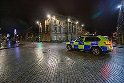 31DEC20 Police on High Street, Edinburgh on Hogmanay.