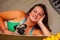 Teenaged girl on a hammock with her pug (dog), Littleton, Colorado USA