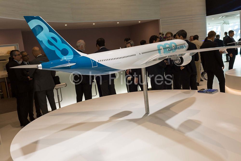 A scale model of the Airbus A330-900 airliner and Airbus employees in the companys hospitality chalet at the Farnborough Airshow, on 18th July 2018, in Farnborough, England.