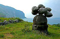 """Niijima Moai - Though they are called """"moai"""" these artifacts are more like outdoor sculptures, dotted along the coastline of Niijima. Oddly enough, Niijima Island is a part of Tokyo although it in no way resembles the crowded city - or any city for that matter.  In fact, it is more of a tropical paradise and hangout for surfer dudes, with huge wages and surf.  To make life more interesting, or some other reason, Niijima also has a smattering of moai or public art sculptures along the coast.  Though they are called """"moai"""" these artifacts are more sculptures, dotted along the coastlines of Niijima.  Most of them are made of ryolite, a precious volcanic rock that is mined only on Niijima.  These sculptures are actually called moyai by the locals which means 'work together' in their dialect."""