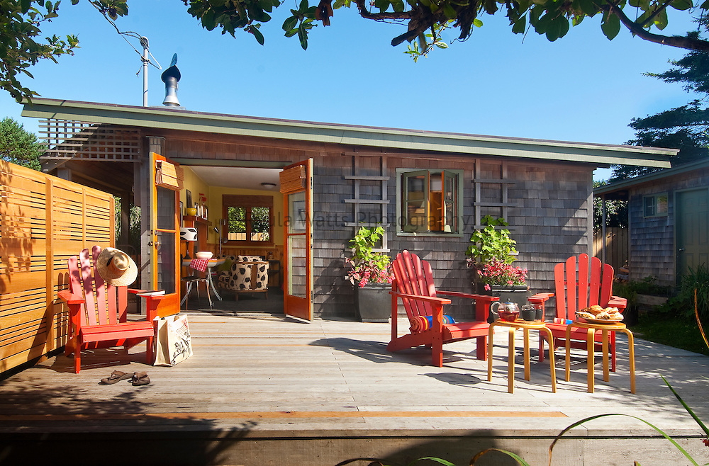 Tiny beach house exterior with large deck to showcase lifestyle