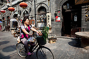 Hutong street in Xuanwu district, an area just south of Tiananmen in Beijing, China. Hutongs are a type of narrow streets or alleys, most commonly associated with Beijing, China. In Beijing, hutongs are alleys formed by lines of siheyuan, traditional courtyard residences. Many neighbourhoods were formed by joining one siheyuan to another to form a hutong, and then joining one hutong to another neighbourhood. Since the mid-20th century, the number of Beijing hutongs has dropped dramatically as they are demolished to make way for new roads and buildings. More recently, some hutongs have been designated as protected areas in an attempt to preserve this aspect of Chinese cultural history.