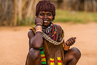 Hamer tribe woman in her village, Omo Valley, Ethiopia.