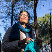 Mala Srikanth, founder of the women's knitting circle in Ranikhet, India, works on a personal sweater in the forest behind her home in Ranikhet, India on Dec. 6, 2018.
