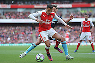 Alexis Sanchez of Arsenal blocks the ball from Gaston Ramirez of Middlesbrough.Premier league match, Arsenal v Middlesbrough at the Emirates Stadium in London on Saturday 22nd October 2016.<br /> pic by John Patrick Fletcher, Andrew Orchard sports photography.