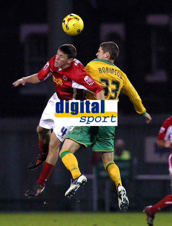Photo: Dave Linney.<br />Crewe Alexandra v Norwich City. Coca Cola Championship.<br />10/12/2005.Billy Jones(Crewe) in an aerial dual with  Carl Robinson(Norwich)