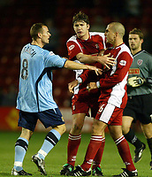 Photograph: Scott Heavey.<br />Walsall v Bradord City. Nationwide Division One. 06/12/2003.<br />Michael Branch and Paul Ritchie come to blows