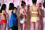 LIUZHOU, CHINA - MARCH 08: (CHINA OUT) <br /> <br /> Celebrating female power, Chinese style: Shopping mall hosts bra-undoing contest on International Women's Day <br /> <br /> A shopping mall in China seemed to have got the wrong idea when celebrating International Women's Day with a one handed bra competition.<br /> Six scantily clad female models lined up on a stage at the store in Liuzhou city on March 8, as men and women took it in turns to undo their bras using only one hand.<br /> Bizarrely the models had masks on as they stood with their backs to the crowd. The winner was a woman who managed to undo all six bras in 14 seconds. <br /> <br /> At the event, a total of eight spectators volunteered to take part in the competition, but surprisingly according to China Daily, only one of them was a man.<br /> The aim of the game was to undo each bra with one hand in the fastest time possible.<br /> Not only did the models participate in the contest, they strutted their stuff on the stage wearing only their underwear and a mask as dozens of prying customers looked on. <br /> According to the report, the contest was put on to attract more customers on International Woman's Day.<br /> But it seems whoever's idea it was to hold a one handed bra competition using nearly naked models, they may have not understood the meaning of the day.<br /> It is not clear in the report what the prize was for the winner of the competition. <br /> This is not the first time businesses in China have come under fire for 'missing the point' on International Women's Day.<br /> In 2015, two of the country's most popular websites were criticised for using 'sexist stereotypes' on the day that is celebrated by millions across the globe. <br /> Search engine Baidu had a ballerina in a pink dress, who turned into a bride and then into a mother pushing a baby, on its homepage.<br /> And video-sharing site Youku, wrote to all its female users on its page: 'May the world treat you gently.'<br /> Acco