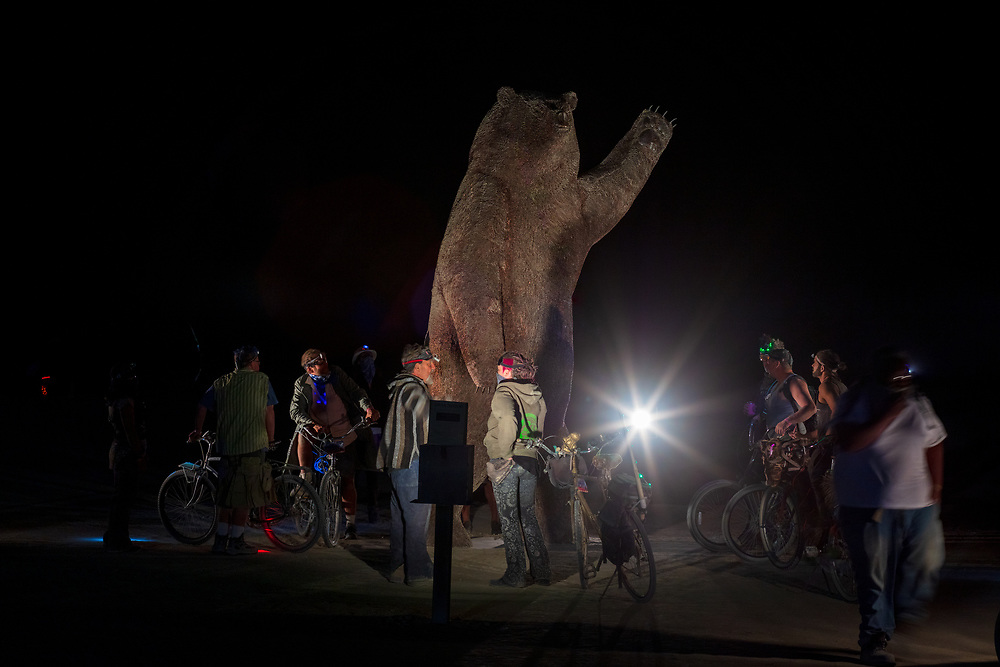 Ursa Major from: Alameda, California year: 2016<br /> <br /> Reaching to grab what is within her grasp is Ursa Major, a 14 foot tall, grizzly bear sow. She may simply be reaching for berries but perceivably she is reaching higher: to the northern sky and the constellation that is her name, Ursa Major. In navigation, the constellation is useful in pointing the way to the North Star.<br /> Ursa Major's pose is inspiring, she brings the gaze and hopes of the participant skyward. She also demonstrates respect for the bears and nature, her pose is not like a taxidermy bear. She is in her natural state and unthreatening. With a durable, unique material that was used on their previous Burning Man project (Penny the Goose), Ursa Major's fur will be made of US and Canadian pennies. The pattern and feel will be like fur. URL: https://www.facebook.com/Mr-and-Mrs-Ferguson-Art-434710516694820/ Contact: lisa@lisa-and-camera.com