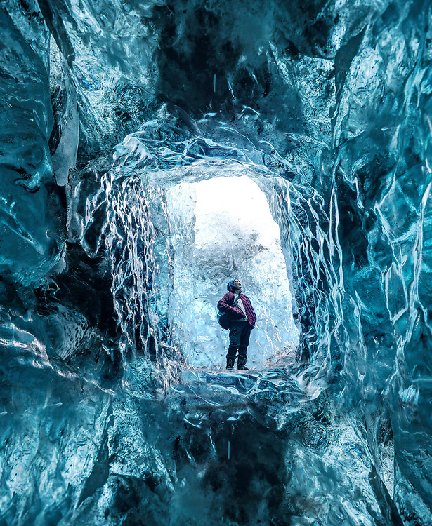 Mai Shurtleff explores an ice cave in the Vatnajökull Glacier located in southeast Iceland. Photo/Andrew Shurtleff Photography, LLC
