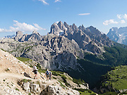 """The peaks of the Cadini Group jut high in the Sesto Dolomites near Cortina d'Ampezzo, Italy, Europe. In the Cadini di Misurina, Cima Grande rises to 2999 meters (9839 feet), between Cima Piccola and Cima Ovest. Hike for spectacular views around Tre Cime di Lavaredo (Italian for """"Three Peaks of Lavaredo,"""" or in German called Drei Zinnen, """"Three Merlons""""). The Dolomites are part of the Southern Limestone Alps, in northern Italy, Europe. UNESCO honored the Dolomites as a natural World Heritage Site in 2009."""