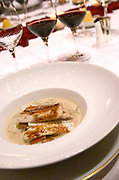 Dinner in the George V luxury restaurant in Paris. Fish in a white wine sauce. Paris, France.