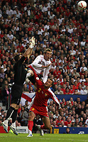 Photo: Paul Thomas.<br /> England v Macedonia. UEFA European Championships 2008 Qualifying. 07/10/2006.<br /> <br /> Peter Crouch (White) of England tries to win the header before keeper Jane Nikoloski (L) and NikolceNoveski (2).