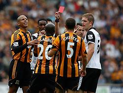 Referee Mike Jones sends off Hull City's Yannick Sagbo for headbutting  - Photo mandatory by-line: Matt Bunn/JMP - Tel: Mobile: 07966 386802 24/08/2013 - SPORT - FOOTBALL - KC Stadium - Hull -  Hull City V Norwich City - Barclays Premier League