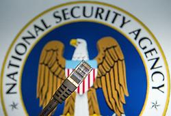 THEMENBILD - Netzueberwachung. Das Bild wurde am 30. Oktober 2013 aufgenommen. im Bild Netzwerkkabel vor National Security Agency (NSA) Logo // THEMES PICTURE - Monitoring of Internet Use. The image was taken on october, 30th, 2013. Picture shows network cable in front of National Security Agency (NSA) Emblem, AUT, EXPA Pictures © 2013, PhotoCredit: EXPA/ Michael Gruber