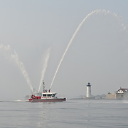 Closeup of the City of Portsmouth Fire Boat as it escorts tall ship Gazela past Portsmouth Light and Fort Constitution on New Castle, as Gazela enters the Portsmouth, NH harbor.