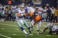 28 AUG 2014: Dallas Cowboys quarterback Dustin Vaughan (10) spins out of a sack attempt by Denver Broncos linebacker Steven Johnson (53) during the final NFL American Football Herren USA preseason game between the Denver Broncos and Dallas Cowboys at AT&T Stadium in Arlington, TX. NFL American Football Herren USA AUG 28 Preseason - Broncos at Cowboys PUBLICATIONxINxGERxSUIxAUTxHUNxRUSxSWExNORxONLY Icon140828784<br /> <br /> 28 Aug 2014 Dallas Cowboys Quarterback Dustin Vaughan 10 Spins out of A Bag Attempt by Denver Broncos Linebacker Steven Johnson 53 during The Final NFL American Football men USA Preseason Game between The Denver Broncos and Dallas Cowboys AT AT Stage in Arlington TX NFL American Football men USA Aug 28 Preseason Broncos AT Cowboys PUBLICATIONxINxGERxSUIxAUTxHUNxRUSxSWExNORxONLY