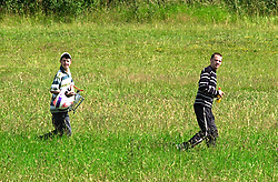 Two young men walk onto Westwood country park carring a motorcycle crash helmet during a police operation against illegal off road biking in the High Green area Sunday <br /><br />Image Copyright Paul David Drabble<br /><br />29 June 2003<br /><br />Copyright  Paul David Drabble<br /><br />[#Beginning of Shooting Data Section]<br />Nikon D1 <br /><br />2003/06/29 10:26:44.0<br /><br />JPEG (8-bit) Fine<br /><br />Image Size:  2000 x 1312<br /><br />Color<br /><br />Lens: 80-200mm f/2.8-2.8<br /><br />Focal Length: 200mm<br /><br />Exposure Mode: Programmed Auto<br /><br />Metering Mode: Multi-Pattern