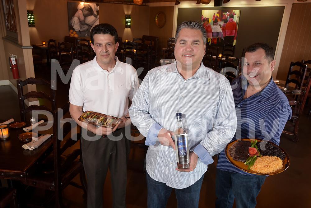 Mark Black/mblack@dailyherald.com<br /> En Fuego Mexican Grille's Chef Guillerueo Alaniz, Owner Joe Fernandez and Marketing Director Gil Rangel.  Fernandez is holding a bottle of their house tequila, El Nacimiento