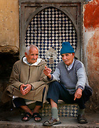 Early Monday morning, May 28, 2007, two men gather at one of several hundred fountains that make Fes, Morocco so unique. This particular fountain is located near the entrance to Bab Sammarine in the Fes Al- Jedid or Jewish quarter. Water is a symbol of life and power here in Fes. Water supplies have been becoming scarcer over the years, a troubling sign for people here.  (PHOTO BY TIMOTHY D. BURDICK)