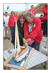 Day five of the Fife Regatta, lay day in Portavadie<br /> <br /> Kentra and Astor 90th Birthday<br /> <br /> Doris  Klaus with Lani Straman cutting the cake<br /> <br /> <br /> * The William Fife designed Yachts return to the birthplace of these historic yachts, the Scotland's pre-eminent yacht designer and builder for the 4th Fife Regatta on the Clyde 28th June–5th July 2013<br /> <br /> More information is available on the website: www.fiferegatta.com