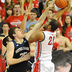 Notre Dame Fighting Irish forward Tom Knight (25) blocks Rutgers Scarlet Knights forward/center Austin Johnson's (21) shot during Big East NCAA action during Rutgers' 65-58 victory over Notre Dame at the Louis Brown Athletic Center in Piscataway, N.J.