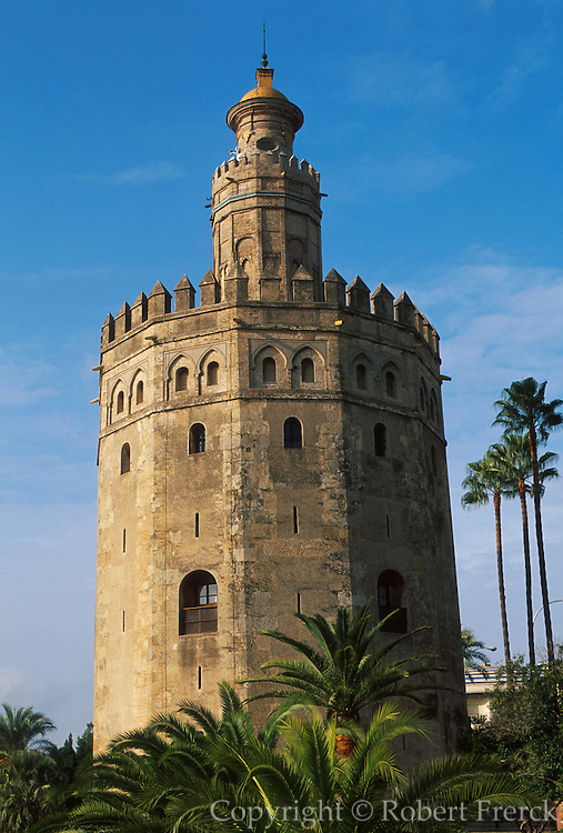 SPAIN, ANDALUSIA, SEVILLE Torre del Oro (Gold Tower) 1220AD; part of the Moorish walls that surrounded the city along the Guadalquivir River