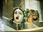 Theatrical masks of reprsenting Tragedy and Comedy depicted in Ancient Roman mosaic.