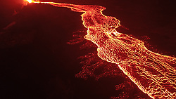 Handout photo of drone image of the fissure 8 lava channel looking toward the vent. Overflows can be seen as incandescent spots beyond the channel margins. Drone flights and resultant imagery help scientists better identify areas of channel overflows and active flow advancement. Incandescence (glowing) lava is easier to identify in the dark versus during daylight hours. Kilauea Volcano, HI, USA, July 2, 2018. Photo by USGS via ABACAPRESS.COM