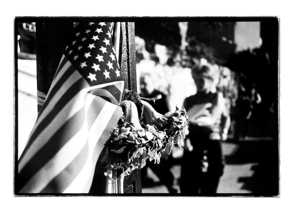 In the days before 9/11, these makeshift memorial shrines started to appear all over the city. Every lamp post, almost every traffic light in the city had the Stars and Stripes attached to it together with flowers and cards full of messages mourning lost ones.