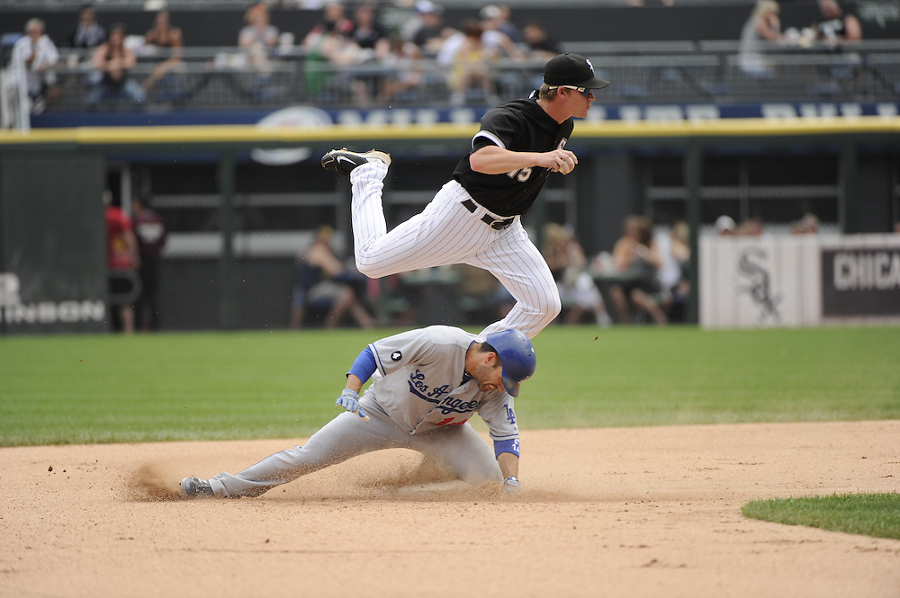 CHICAGO - MAY 22:  Gordon Beckham #15 of the Chicago White Sox makes a force out at second base as Jamey Carroll #14 of the Los Angeles Dodgers breaks up the double play in the sixth inning on May 22, 2011 at U.S. Cellular Field in Chicago, Illinois.  The White Sox defeated the Dodgers 8-3.  (Photo by Ron Vesely)  Subject:   Gordon Beckham;Jamey Carroll