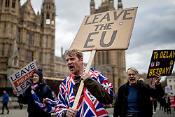 "© Licensed to London News Pictures. 13/03/2019. London, UK. Pro-Brexit protesters march through Westminster as MPs continue to debate a series of key votes on Brexit. MPs will vote on whether to remove the option of a ""no deal"" departure from the EU today, after Prine Minister Theresa May's proposed deal was defeated for a second time last night. Photo credit: Rob Pinney/LNP"