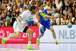 Laszlo Nagy #19 of Hungary and Marko Bezjak #8 of Slovenia during handball match between National teams of Slovenia and Hungary in play off of 2015 Men's World Championship Qualifications on June 15, 2014 in Rdeca dvorana, Velenje, Slovenia. Photo by Urban Urbanc / Sportida