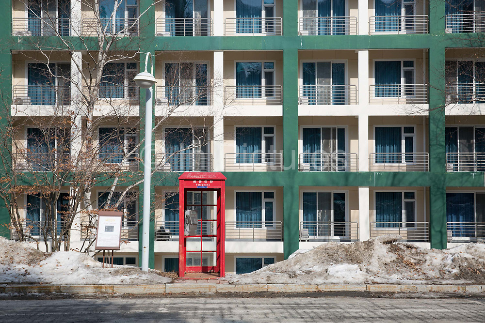 A red telephone box in the afternoon sunlight on February 16th 2018 at the Pheonix Snow Park in Pyeongchang-gun, South Korea.