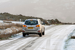 © Licensed to London News Pictures. 28/01/2020. Howey, Powys, Wales, UK.A motorist negotiates a road in a wintry landscape near Howey in Powys, Wales, UK. Photo credit: Graham M. Lawrence/LNP