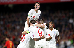 England's Raheem Sterling (obscured) celebrates scoring his side's third goal of the game during the Nations League match at Benito Villamarin Stadium, Seville.