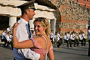 Moscow, Russia, 15/07/2006..A military officer dances to music from his own brass band in Alexandrovskii Gardens beside the Kremlin..