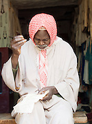 A needlework man in his shop in Djenné, Mali