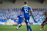 AFC Wimbledon defender Ben Heneghan (22) performing slide tackle during the EFL Sky Bet League 1 match between AFC Wimbledon and Hull City at Plough Lane, London, United Kingdom on 27 February 2021.