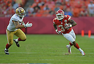 KANSAS CITY, MO - AUGUST 16:  Running back Knile Davis #34 of the Kansas City Chiefs rushes against linebacker Dan Skuta #51 of the San Francisco 49ers during the first half on August 16, 2013 at Arrowhead Stadium in Kansas City, Missouri.  (Photo by Peter Aiken/Getty Images) *** Local Caption *** Knile Davis;Dan Skuta