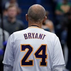 Jan 26, 2020; New Orleans, Louisiana, USA;  A fan wearing a jersey in tribute to former Los Angeles Lakers star Kobe Bryant whom died in a helicopter crash Sunday morning prior to tip off of a game between the New Orleans Pelicans and the Boston Celtics at the Smoothie King Center. Mandatory Credit: Derick E. Hingle-USA TODAY Sports