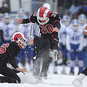 Peter Swindell, New Canaan, kicks a field goal during the New Canaan Rams Vs Darien Blue Wave, CIAC Football Championship Class L Final at Boyle Stadium, Stamford. The New Canaan Rams won the match in snowy conditions 44-12. Stamford,  Connecticut, USA. 14th December 2013. Photo Tim Clayton