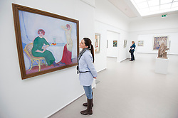 Woman looking at painting Composition ( Earthly and Heavenly Love) at Kroller-Muller Museum in The Netherlands