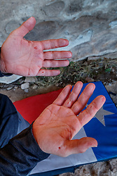 Hands of Sarah Hepola after day of climbing boulders at Hueco Tanks State Park & Historic Site, El Paso, Texas. USA.
