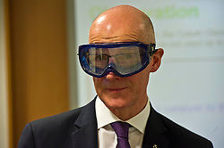 Pictured: John Swinney donned safety glasses for his visit to the Chemistry class of Philip Wooton<br /> <br /> Deputy First Minister and Education Secretary John Swinney visited St Augiustine's RC High School in Edinburgh to speak to young people about attainment and leaving schools with the suite of statistics published today. St Augustine's RC High School<br /> <br /> <br /> Ger Harley | EEm 19 June 2018